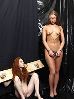 One slave in chains, one slave in stocks, inspected by Master.