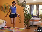 Schoolgirl bound in her own jump rope.
