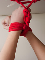 Pretty bondage amateur tied in red rope