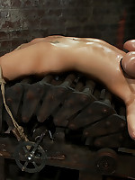 Blonde bent backwards over rack and forced to cum