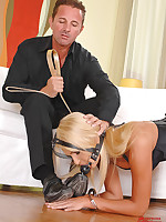 Blonde slave collared, gagged and used as furniture