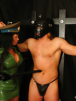 Male slave training by dominatrix in latex uniform