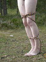 Naked brunette exposed outside, bound and flogged
