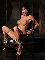 Pretty girl struggles in inescapable chair bondage