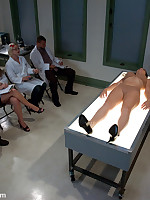 Patient endures sexual examination by three dominants