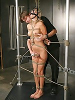 Stringent bondage for sexy blonde