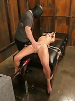 Redhead suspended, spanked and penetrated