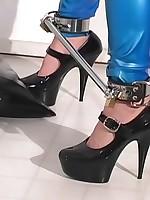 Girl in a blue latex catsuit struggled in bondage