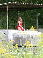 Blonde spread outdoors on a stone slab and whipped