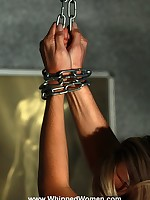 Chained into predicament bondage, a posh blonde is ass whipped