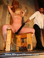 Blonde is bound to a chair, legs spread, for harsh pussy whipping