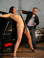 Woman bound naked to the trunk of a car and whipped
