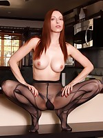 Redhead good-luck piece girl in louring patterned pantyhose