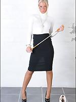 Strict Domme poses in slit skirt