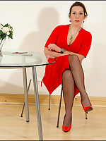 Domme in red dress teases black slaveboy