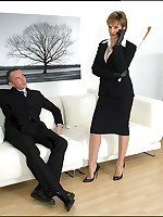 Domme disciplines a businessman with her cane