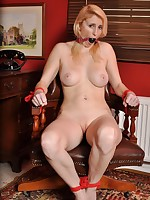 Large boobed naked floosie fastened up nigh a chairperson