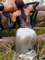 Latex dial confronting lesbo babes