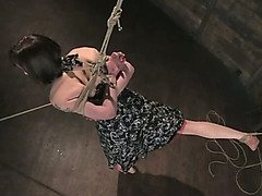 Girl in predicament bondage is teased by Domme