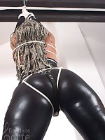 Hanging girl in latex
