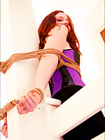 Here she is mercilessly tied to a post, her whole body held in place by unforgiving ropes and gags