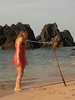 Girl is collared, leashed, bound and stranded on the beach