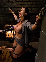 Girl in business suit bound and tormented
