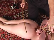Rose must escape the hogtie or receive a lashing with the cane