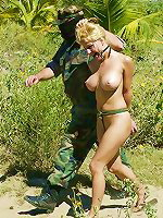 Blonde bondaged by military man