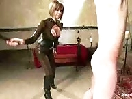 Maitresse Madeline covers slaves cock