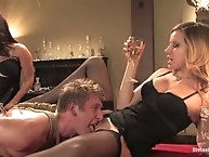 Two sexy dominatrices use a piece of slaveboy