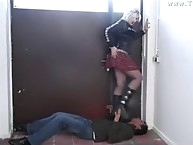 Blonde shoe trampling action on handsome guy