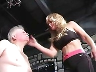 Sexy chick spanks and spits on his face
