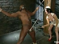 Sexy white domme tortures black slaves