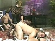 Slaveboy getting straponed in dungeon