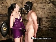 Latex bit of skirt teasing slave's dick