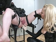 Twosome latex mistresses prostate play together with pinpointing servant on high gyno preside
