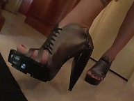 Blonde mistress uses footslave