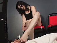 The hot dominant brunette tramples slave by her sexy legs