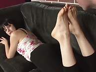 Mistress Kylie is busy getting her feet licked