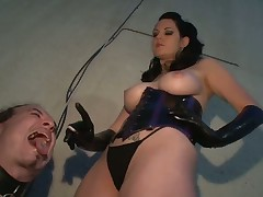 Smoking Dominatrix with her slave in dirty games
