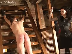 Dominatrix was whipping her slave very hard