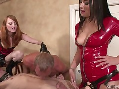 Two hot mistresses in latex were torturing penis