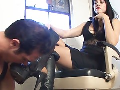 Poor boot slave getting harsh humiliation from domme