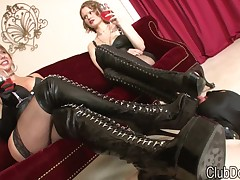 Slave dude is getting a double strapon fuck from mistress