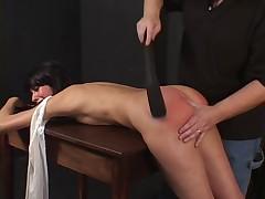 Hot brunette spanked hard by her master