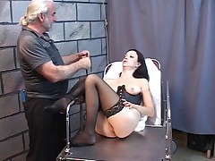Cute young brunette is restrained with ropes and tortured with whips