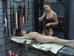 Young lesbians in the sex dungeon get tortured with hot candle wax and whip