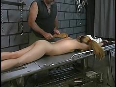 Slut on bondage table gets spanked