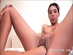 Slim lesbo gets twat fisted and ass spanked